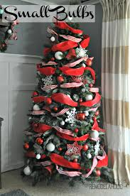 Saran Wrap Christmas Tree With Ornaments by Remodelaholic How To Decorate A Christmas Tree A Designer Look