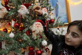 CATHOLIC CHURCH IN JORDAN An Iraqi Girl Decorates A Christmas Tree At Chaldean Catholic Church In Amman Jordan Dec 22 Thousands Of Christians