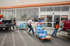 Home Depot employees unload donations of water and other goods at