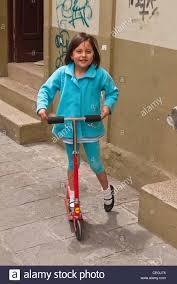A 10 12 Year Old Ecuadorian Girl Rides Her Razor Scooter Outside Home In Latacunga Ecuador