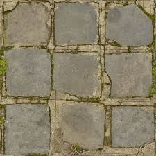 Seamless Texture Of Concrete Tiles With Very Worn Surface And Some Vegetation In Cracks
