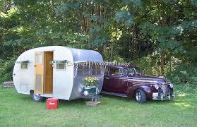 Silver 1951 Comet Canned Ham Vintage Travel Trailer Parked Alongside Is A Black Cherry 1940