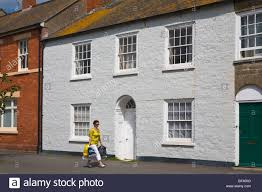 100 Bridport House Woman Walking Passed Traditional Terraced Housing