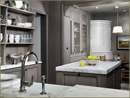 travertine countertops grey stained kitchen cabinets lighting