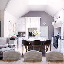 Open Plan Kitchen With Breakfast Bar And Dining Table