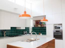 orange pendant lights concrete floor lighting clerestory windows