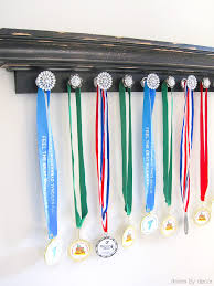 Ledge Shelf With Knobs Attached To Hold Sports Medals