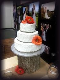 This Simple Rustic Textured Three Tiered Cake Features A Burlap String Border And Fall Colored Flowers Can Be Replicated With Any Ribbon