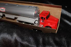 Buy 1975 Texaco Toy Tanker Truck 1995 Edition : Real Headlights ... Amazoncom Ertl 9385 1925 Kenworth Stake Truck Toys Games Texaco Cast Metal Red Tanker Truck By Ertl For Sale Antiquescom Vintage Toy Fuel Tractor Trailer 1854430236 Beyond The Infinity 1940 Ford Pickup With Lot Detail Two 2 Trucks Colctible Set Schrader Oil Vintage Buddy L Gas Pressed Steel Antique Tootsietoy 1915440621 Sold Diamond T 522 Livery Rhd Auctions 26 Andys Toybox Store 273350286110 1990 Edition 7 Stake Coin Bank Collectors Series 9 1961 Buddy