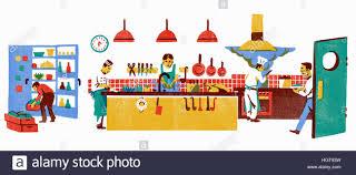 Chefs Working In Busy Restaurant Kitchen