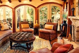 Round Leather Ottoman Living Room Rustic With Arched Windows Area Rug Image By Debra Campbell Design