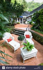 Wicker Lounge Chairs On Patio Of House, Manoa, Honolulu ... Outdoor Interiors Grey Wicker And Eucalyptus Lounge Chair With Builtin Ottoman Berkeley Brown Adjustable Chaise St Simons 53901 Sofas Coral Coast Tuscan Ridge All Weather Stationary Rocking Chairs Set Of 2 Martin Visser Black Wicker Lounge Chairs Hampton Bay Spring Haven Allweather Patio Fong Brothers Co Fb1928a Upc 028776515344 Sheridan Stack Edgewater Rattan From Classic Model 4701 Costway Couch Fniture Wpillow Hot Item Home Hotel Modern Bbq Fire Pit Table Garden