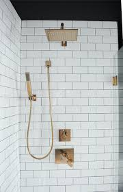 white subway tiles with square brass shower contemporary