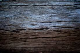 Background Texture Of Old Weathered Dried Grungy Cracked Wood