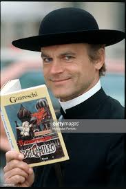 The Italian Actor Terence Hill In Role Of Don Camillo Holding Novel