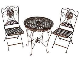 2 chaises et 1 table en fer forgé brun mobilier et décoration de