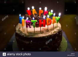 birthday cake with happy birthday candles stock photo alamy