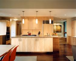 Trendy Kitchen Photo In Seattle With Flat Panel Cabinets And Light Wood