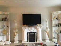 luxus medusa wohnwand säulenvitrine kamin griechisch