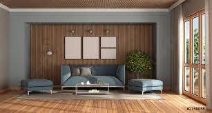 foto auf lager modernes wohnzimmer mit elegantem blauem sofa und fußhocker