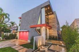 A Hollywood Home With An Atypical Facade - Design Milk Small Minimalist Home With Creative Design Architecture Beast Fantastic Graded House Grey Wall Cubic Facade And Large Glass A That Goes Modern Behind Its Traditional Milk Wooden Facade House Design By Saota Family Open Space In Montral Canada Beechmont 204 Stroud Homes Facades Singh Rippling Red Brick Shades In Surat Work Group 42 Stunning Exterior Designs Plans For Sale Online