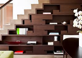modern dark wood shelves sleek drawers below the stairs make a