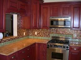 Red Glass Mosaic Tile Backsplash With Red Cherry Cabinets — SMITH