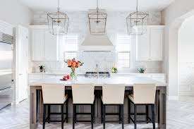 light brown stained kitchen island with barstools