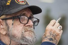 US Marine Corps veteran Martin Silverhawk sits outside a Home
