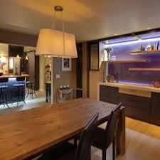 Contemporary Dining Room With Illuminated Accent Wall
