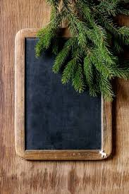 Vintage Empty Chalkboard With Fir Christmas Tree And Small Elk Over Wooden Background Top View