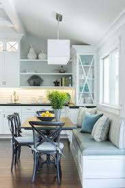 Lovely Eat In Kitchen Is Filled With A Built Dining Bench And Window Seat Facing French