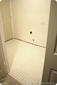 how to out tile in the laundry room from thrifty decor