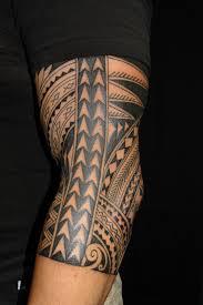 Hawaiian Girl Tattoo On Right Arm Photo