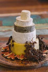 Cheese Wedding Cake Surrounded By Fruit