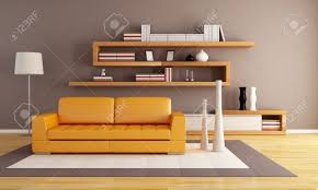 orange and brown living room with modern wooden bookshelf stock