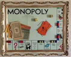 This Piece Is A Framed Vintage Monopoly Game Board With The Original Pieces Arranged As If