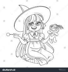 Cute Girl In Witch Costume Sitting On The Floor And Plays With A Voodoo Doll
