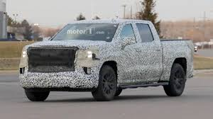 2019 GMC Sierra Shows Up In First Teaser Image All Trims On The Gmc Trucks Explained Eagle Ridge Gm Carbon Fiberloaded Sierra Denali Oneups Fords F150 Wired 2015 Used 1500 Slt At Watts Automotive Serving Salt Lake 2016 Gets Upmarket Ultimate Trim Terrain This Is It Youtube New Hd Smart Capable And Comfortable 2019 Limited In Orange County Hardin Buick 2018 Reviews Rating Motortrend Indepth Model Review Car Driver Pickup Truck 2014 53l 4x4 Crew Cab Test