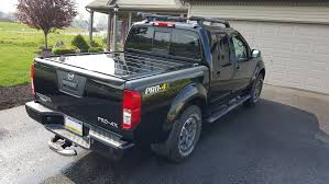 The Truth About Nissan Frontier Bed Cover And Titan Truck ... Soft Rollup Tonneau Cover Pickup Bed Covers For Hilux Revo Buy Undcover Truck Classic How To Install Trifold 199703 Ford F150 Quality Colorful 113 Homemade Ram Bak Ridgelander To Remove A F250 Nutzo Rambox Series Expedition Rack Nuthouse Industries Nice Weathertech Alloycover Hard Tri Fold Top Your With A Gmc Life King Base Bedbuy King Bed Mattress Buy Truxedo Accsories