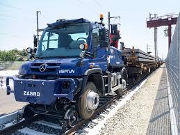 100 Shunting Trucks Loading Clearing Snow Roadrail Unimog At Vigier Rail AG