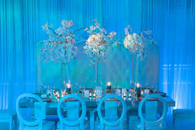 Beach Wedding Reception Blue Lighting Orange Flowers