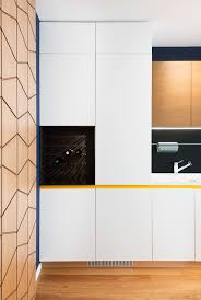 Vintage Metal Kitchen Cabinets by A Mid Century Inspired Apartment With Modern Geometric Accents