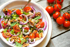 cuisine detox detox food with veggie salad with tomato and walnuts stock
