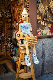 Vintage Wood Toy Shop With Pinocchio Dool Exposed On Front In Ma