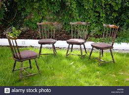 Four Empty Straight Back Wooden Chairs In Garden. Tipperary, Ireland ... Reve Guest Chair Straight Leg Round Back Qty 2 Green Straightback Amish Direct Fniture Chrbackstraightjpg Paul T Cowan Photography Portfolio Pacific Custom Parson Ding Best Outdoor Patio Crate And Barrel Get The Height Right For Stools Trex Chairs Room Wooden Straight Back Ding Chair Wbr Interiors Lawn Usa Making Quality Folding Alinum