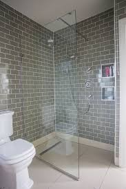 modern bathroom makeover grey brick tiles and pink accessories