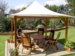 A Tensile Fabric Square Coned Gazebo With Timber Frame