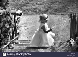 cute girl in white christening dress church steps