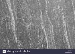 Dark Gray Granite Smooth Stone Wall Texture Background